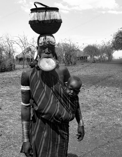 Mursi Tribe | Lip plated face plate decoration